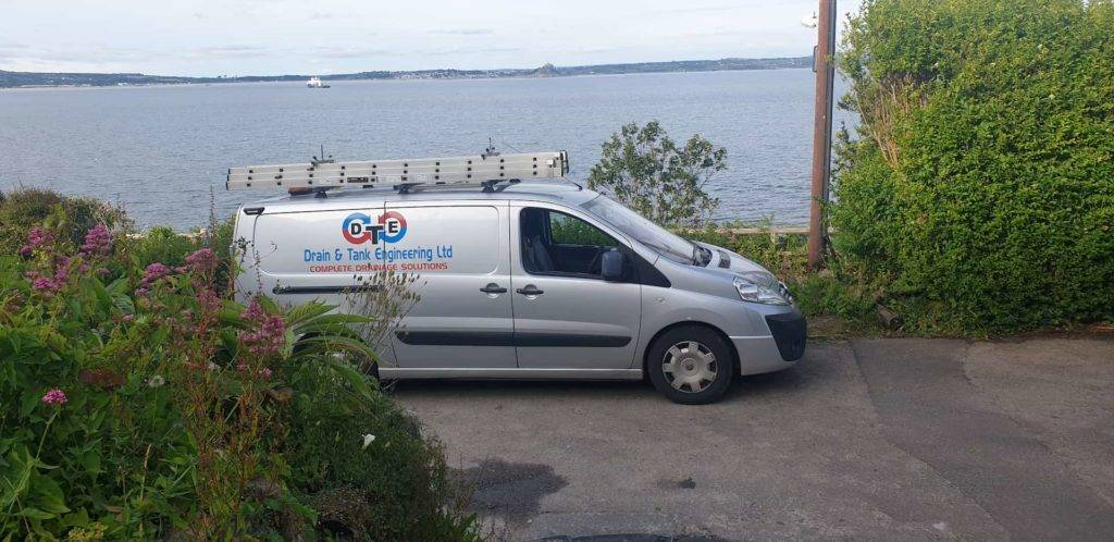 Van with sea view in background